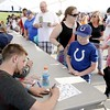 Don Knight | The Herald Bulletin<br /> Chris Neunschwander signs an autograph for a young fan before the Little 500 on Saturday.