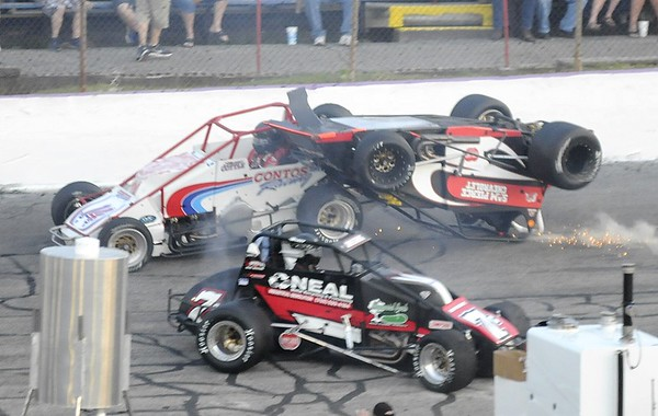 Don Knight | The Herald Bulletin<br /> The  Little 500 is red flagged after Aaron Pierce's car flipped over.