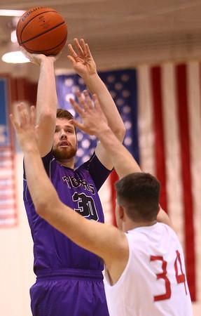 2-28-17<br /> Northwestern vs West Lafayette boys basketball<br /> Trey Richmond shoots.<br /> Kelly Lafferty Gerber | Kokomo Tribune