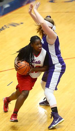 3-9-17<br /> 8th grade girls basketball<br /> Kokomo Red's Sanighia Balantine dribbles around Northwestern's defense.<br /> Kelly Lafferty Gerber   Kokomo Tribune