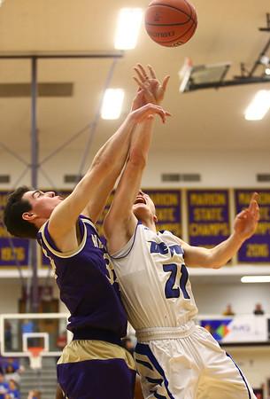 3-11-17<br /> Tipton vs New Haven boys basketball regional semifinal<br /> Tipton's Tyler Slack shoots as New Haven's Joey Rowan tries to block the shot.<br /> Kelly Lafferty Gerber | Kokomo Tribune