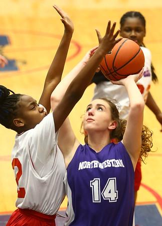 3-9-17<br /> 8th grade girls basketball<br /> NW's Caraline Brandt puts up a shot.<br /> Kelly Lafferty Gerber | Kokomo Tribune