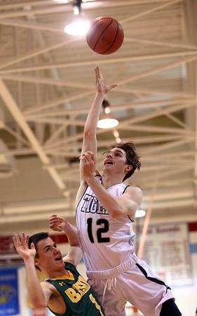 2-28-17<br /> Peru vs Benton Central boys basketball<br /> Peru's Nathan Mosher puts up a shot.<br /> Kelly Lafferty Gerber | Kokomo Tribune