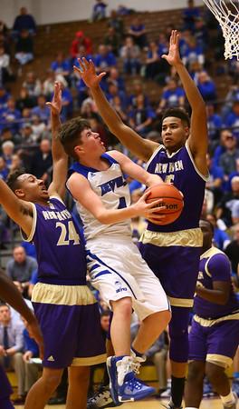 3-11-17<br /> Tipton vs New Haven boys basketball regional semifinal<br /> Tipton's Lukas Swan looks for a shot over New Haven's defense.<br /> Kelly Lafferty Gerber | Kokomo Tribune