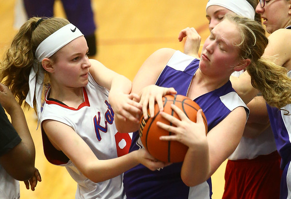 3-9-17<br /> 8th grade girls basketball<br /> Kokomo Red's Madison Collins and NW's Elizabeth Zentz both go after control of the ball.<br /> Kelly Lafferty Gerber | Kokomo Tribune