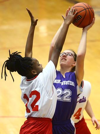 3-9-17<br /> 8th grade girls basketball<br /> NW's Layla Kinnaman shoots.<br /> Kelly Lafferty Gerber | Kokomo Tribune