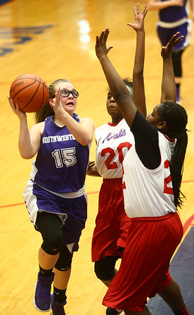 3-9-17<br /> 8th grade girls basketball<br /> NW's Jena Loer shoots.<br /> Kelly Lafferty Gerber | Kokomo Tribune