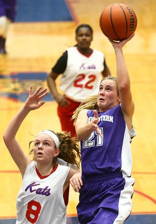 3-9-17<br /> 8th grade girls basketball<br /> NW's Ellie Boyer shoots.<br /> Kelly Lafferty Gerber | Kokomo Tribune