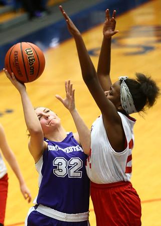 3-9-17<br /> 8th grade girls basketball<br /> NW's Ashlynn Bammerlin puts up a shot.<br /> Kelly Lafferty Gerber | Kokomo Tribune