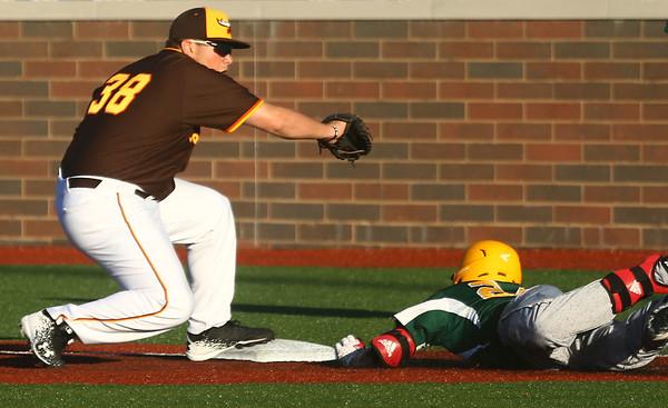5-31-17<br /> Jackrabbits vs Miners<br /> First baseman #38 gets Miners' Kyle Bergeron out at first.<br /> Kelly Lafferty Gerber | Kokomo Tribune