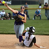 5-23-17<br /> Northwestern vs Western softball<br /> NW's Sophia Beachy throws to first in an attempt for a double play after getting Western's Emma Key out at second.<br /> Kelly Lafferty Gerber | Kokomo Tribune