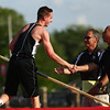 5-18-17<br /> Boys track and field<br /> Western's Zach Zentz shakes hands with coaches after he clears the bar at 12 feet, winning the pole vault sectional with a PR.<br /> Kelly Lafferty Gerber | Kokomo Tribune