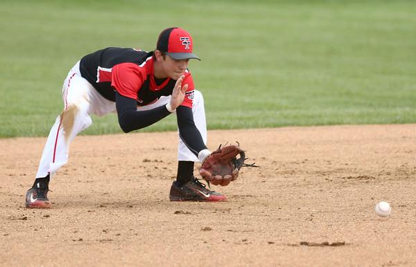 5-6-17<br /> Taylor vs TC baseball<br /> Wynn Takacs scoops up the ball.<br /> Kelly Lafferty Gerber | Kokomo Tribune