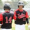 5-6-17<br /> Taylor vs TC baseball<br /> Cole Braun, right, is congratulated by a teammate after Braun scores a run.<br /> Kelly Lafferty Gerber | Kokomo Tribune