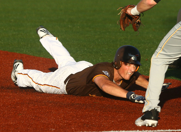 5-31-17<br /> Jackrabbits vs Miners<br /> Luke Fegan slides safely to third base.<br /> Kelly Lafferty Gerber | Kokomo Tribune
