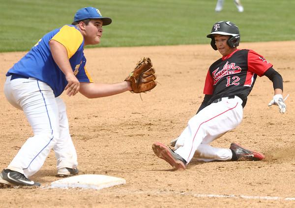 5-6-17<br /> Taylor vs TC baseball<br /> Cole Braun slides to third and is safe.<br /> Kelly Lafferty Gerber   Kokomo Tribune