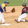 5-6-17<br /> Taylor vs TC baseball<br /> Cole Braun slides to third and is safe.<br /> Kelly Lafferty Gerber | Kokomo Tribune