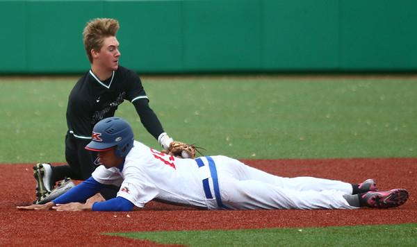5-2-17<br /> Kokomo vs Zionsville baseball<br /> Zionsville's Michael Rocco tags Kokomo's Perry McCullum out as he slides to second.<br /> Kelly Lafferty Gerber | Kokomo Tribune