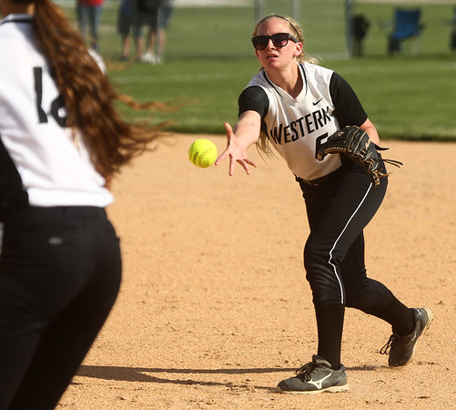5-23-17<br /> Northwestern vs Western softball<br /> Western's Tori Turner tosses to first for an out.<br /> Kelly Lafferty Gerber | Kokomo Tribune