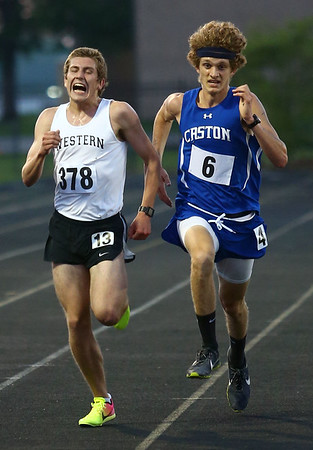 5-25-17<br /> Boys track and field regional<br /> Western's Josh Everetts and Caston's Mitchell Rans battle it out near the finish line in the 3200.<br /> Kelly Lafferty Gerber | Kokomo Tribune