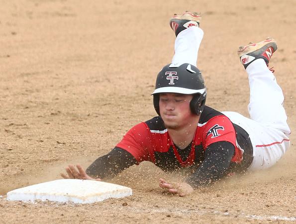 5-6-17<br /> Taylor vs TC baseball<br /> Noah Poe slides to third and is safe.<br /> Kelly Lafferty Gerber   Kokomo Tribune