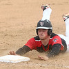 5-6-17<br /> Taylor vs TC baseball<br /> Noah Poe slides to third and is safe.<br /> Kelly Lafferty Gerber | Kokomo Tribune