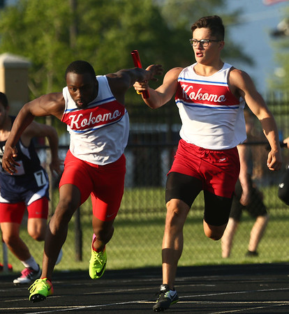 5-18-17<br /> Boys track and field<br /> Joseph Nieto passes to Andrecus Eddington in the 4x100 relay.<br /> Kelly Lafferty Gerber | Kokomo Tribune