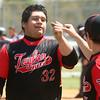 5-6-17<br /> Taylor vs TC baseball<br /> Anthony Ramirez fist bumps one of his teammates after Ramirez scores a run.<br /> Kelly Lafferty Gerber | Kokomo Tribune