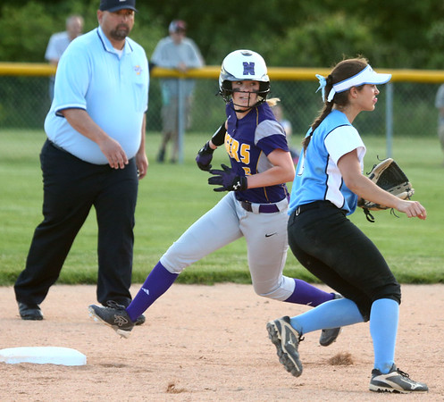 5-30-17<br /> Northwestern vs South Bend Saint Joseph<br /> Bailey Thatcher runs to second.<br /> Kelly Lafferty Gerber | Kokomo Tribune