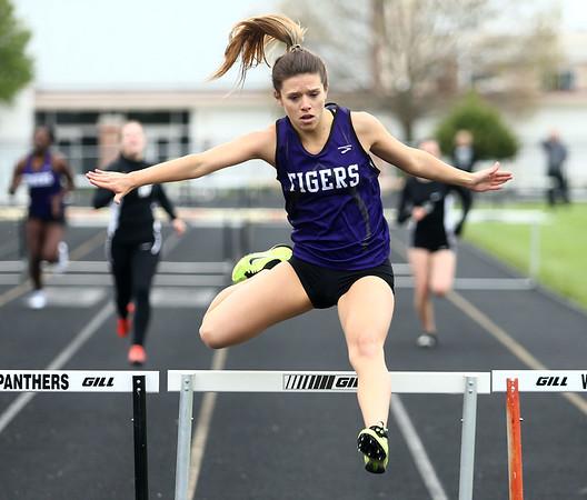 5-3-17<br /> WHS vs NWHS track<br /> NW's Madison Prifogle in the 300 hurdles.<br /> Kelly Lafferty Gerber | Kokomo Tribune
