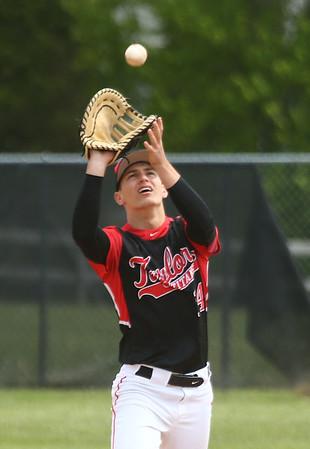 5-6-17<br /> Taylor vs TC baseball<br /> Bailey Owens makes the catch for an out.<br /> Kelly Lafferty Gerber | Kokomo Tribune