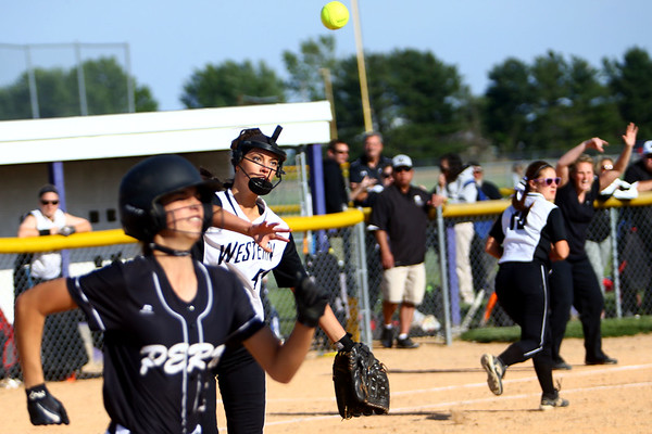 Softball sectional between Western HS and Peru HS on May 20, 2017. Western pitcher Morgan Tuberty throwing the ball Peru's Meagan Sinkovics hit, to first for an out but advancing Iriyale Malone in the 6th inning. Malone was tagged out at home later in the inning.<br /> Tim Bath | Kokomo Tribune