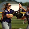 5-30-17<br /> Northwestern vs South Bend Saint Joseph<br /> Crystal Metz highfives teammates after a strikeout.<br /> Kelly Lafferty Gerber | Kokomo Tribune