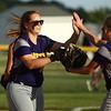 5-30-17<br /> Northwestern vs South Bend Saint Joseph<br /> Crystal Metz highfives teammates after a strikeout.<br /> Kelly Lafferty Gerber | Kokomo Tribune