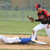 5-6-17<br /> Taylor vs TC baseball<br /> Bailey Owens gets TC's Ryan Cockrum out as he slides back to first.<br /> Kelly Lafferty Gerber | Kokomo Tribune