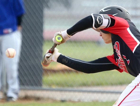 5-6-17<br /> Taylor vs TC baseball<br /> Wynn Takacs bunts.<br /> Kelly Lafferty Gerber | Kokomo Tribune