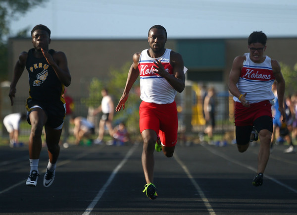 5-18-17<br /> Boys track and field<br /> Kokomo's Andrecus Eddington in the 100 m dash.<br /> Kelly Lafferty Gerber | Kokomo Tribune