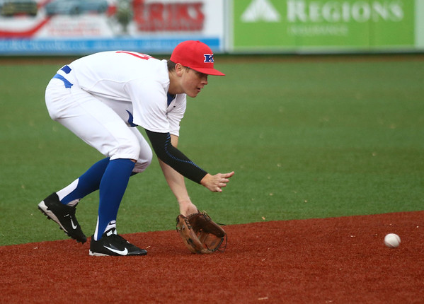 5-2-17<br /> Kokomo vs Zionsville baseball<br /> Bayden Root scoops up the ball<br /> Kelly Lafferty Gerber | Kokomo Tribune