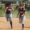 5-23-17<br /> Northwestern vs Western softball<br /> Sophia Beachy, left, and Bailey Thatcher celebrate after a good defensive inning.<br /> Kelly Lafferty Gerber | Kokomo Tribune