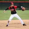 5-6-17<br /> Taylor vs TC baseball<br /> Wynn Takacs throws to first for an out.<br /> Kelly Lafferty Gerber | Kokomo Tribune