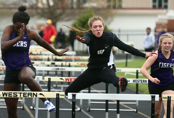 5-3-17<br /> WHS vs NWHS track<br /> Western's Mallory Winger in the hurdles.<br /> Kelly Lafferty Gerber | Kokomo Tribune