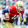CHAD WEAVER | THE GOSHEN NEWS<br /> Notre Dame sophomore quarterback Ian Book runs the ball during the first half of Saturday's Blue-Gold Game at Notre Dame Stadium.