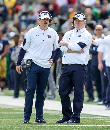 CHAD WEAVER | THE GOSHEN NEWS<br /> Notre Dame first-year coaches Tom Rees (quarterbacks) and Chip Long (offensive coordinator) look on during the second half of Saturday's Blue-Gold game at Notre Dame Stadium.