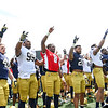 CHAD WEAVER | THE GOSHEN NEWS<br /> Notre Dame players gather for the alma mater following Saturday's Blue-Gold game at Notre Dame Stadium.