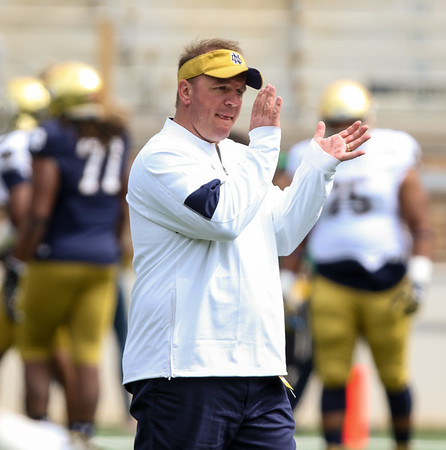 CHAD WEAVER   THE GOSHEN NEWS<br /> First- year Notre Dame defensive coordinator Mike Elko applauds prior to the start of Saturday's Blue-Gold game at Notre Dame Stadium.