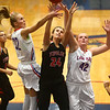11-8-17<br /> Kokomo vs Taylor girls basketball<br /> Taylor's Brooke McGuire tries to go up for a shot as Brittany Barnard and Madison Wood try to block.<br /> Kelly Lafferty Gerber | Kokomo Tribune