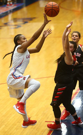 11-8-17<br /> Kokomo vs Taylor girls basketball<br /> Tionna Brown shoots.<br /> Kelly Lafferty Gerber | Kokomo Tribune