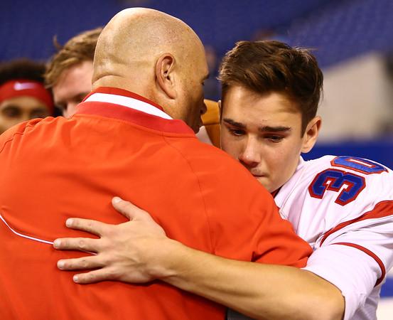 11-24-17<br /> Kokomo state football<br /> Max Waltemath hugs Coach Colby after Kokomo's loss.<br /> Kelly Lafferty Gerber | Kokomo Tribune