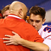 11-24-17<br /> Kokomo state football<br /> Max Waltemath hugs Coach Colby after Kokomo's loss.<br /> Kelly Lafferty Gerber | Kokomo Tribune