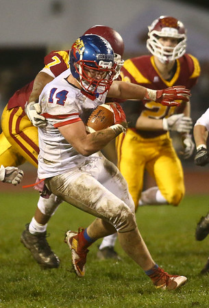 11-3-17<br /> Kokomo vs McCutcheon sectional championship<br /> Luke Cameron runs the ball.<br /> Kelly Lafferty Gerber | Kokomo Tribune